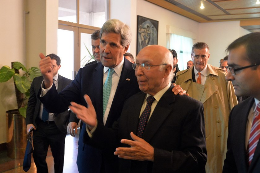 US Secretary of State John Kerry (L) and Pakistan's National Security Advisor Sartaj Aziz leave after a joint press conference at the Foreign Ministry in Islamabad on January 13, 2015. Photo: AFP