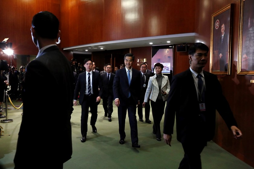 Hong Kong Chief Executive Leung Chun-ying (C) leaves the Legislative Council with security personnel after giving his annual policy address in Hong Kong January 14, 2015. Photo: Reuters