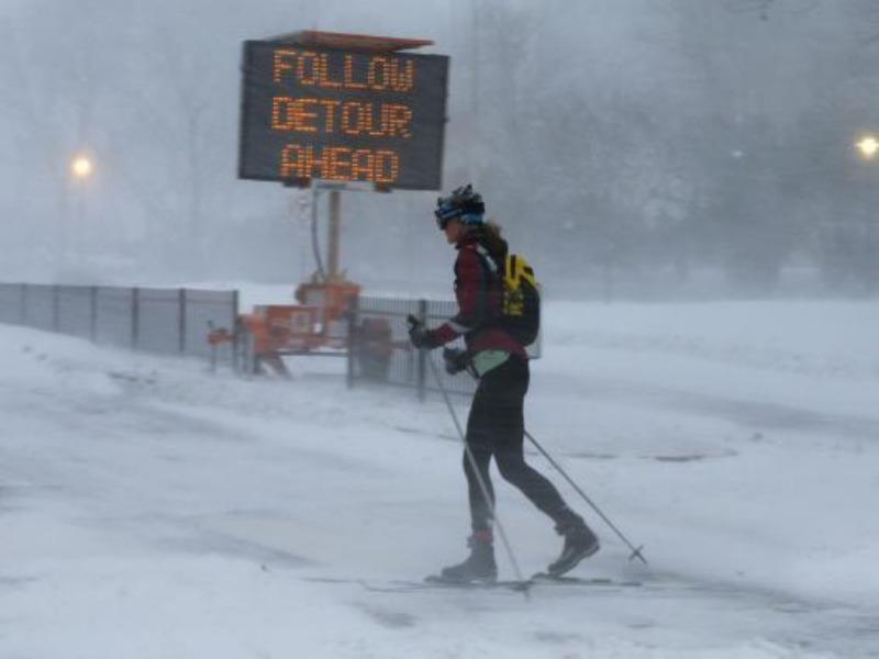 A woman cross country skis on snow covered roads during a large winter blizzard in Cambridge, Massachusetts January 27, 2015. Photo: Reuters/Brian Snyder