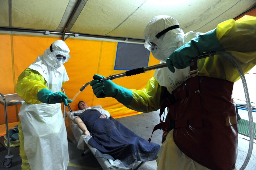 Members of Medecins Sans Frontieres (MSF) and EPRUS, wearing personal protective Equipment (PPE), take part in a training session held by the military trained Civil Security (Securite civile), on checking and treating suspected victims of the Ebola virus,
