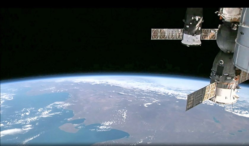 This August 12, 2014 NASA image from video taken by High Definition Earth Viewing (HDEV) experiment aboard the ISS, mounted on the External Payload Facility of the European Space Agency's Columbus module, shows the International Space Station (R) above th
