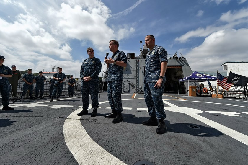 US Rear Admiral Charlie Williams (2nd R), Captain Fred Kacher (3rd R) and Commander Matthew Kawas (R) brief the media during a tour on board the USS Fort Worth (LCS 3), berthed at Sembawang Wharves in Singapore on February 17, 2015. Photo: AFP