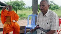 This photo taken on July 23, 2006 shows former Khmer Rouge navy commander Meas Muth (R) sitting next to a Buddhist monk in a pagoda at Anlong Veng district in Oddar Mean Chey province. Photo: AFP