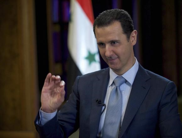 Syria's President Bashar al-Assad is seen during the filming of an interview with the BBC, in Damascus February 9, 2015. Photo credit: Reuters/SANA