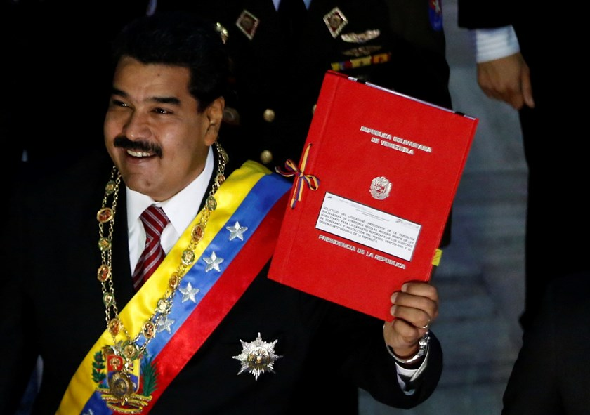 Venezuela's President Nicolas Maduro shows up his petition for decree powers while arriving at the national assembly in Caracas March 10, 2015. Photo: Reuters