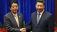 China's President Xi Jinping (R) shakes hands with Japan's Prime Minister Shinzo Abe during their meeting at the Great Hall of the People, on the sidelines of the Asia Pacific Economic Cooperation (APEC) meetings, in Beijing, November 10, 2014. Photo: Reu