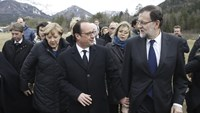France's President Francois Hollande (C), Spain's Prime Minister Mariano Rajoy (R) and German Chancellor Angela Merkel walk on a field near the crash site of Germanwings Airbus A320 near Seyne-les-Alpes in this March 25, 2015 handout. Photo: Reuters/Diego
