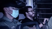 In this file picture taken on November 10, 2014, British banker Rurik Jutting, charged with the grisly murders of two women, smiles as he sits in a prison van leaving the eastern court in Hong Kong. Photo: AFP