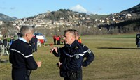 French police discuss operations at the site of the Germanwings Airbus A320 crash, in Seyne-les-Alpes, French Alps, on March 31, 2015. Photo: AFP