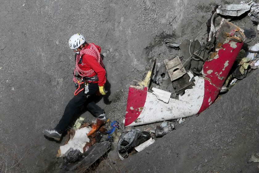 A French rescue worker inspects the remains of the Germanwings Airbus A320 at the site of the crash, near Seyne-les-Alpes, French Alps in this March 29, 2015, file photo. Photo: Reuters