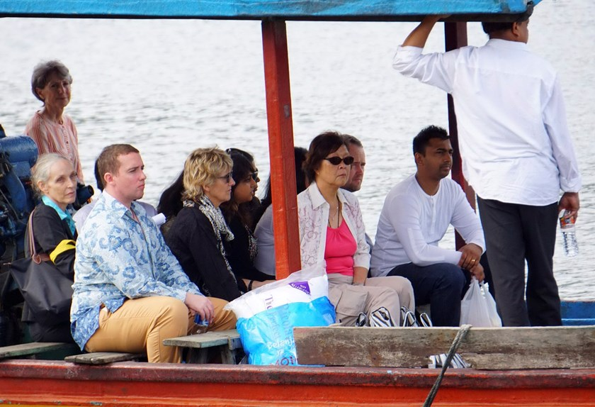 Diplomats, visitors and the family of Australian death row prisoners Myuran Sukumaran and Andrew Chan are seen on a ferry leaving for a family visit towards the prison island of Nusakambangan, where upcoming executions are expected, in Cilacap, Central Ja
