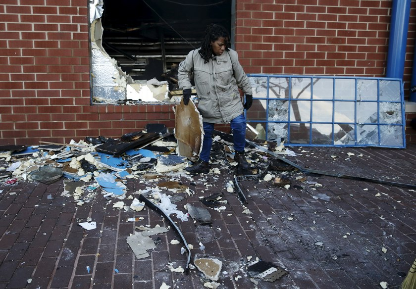 A woman cleans up a CVS store that was looted and set on fire during clashes with police on Monday in Baltimore, Maryland April 28, 2015. Photo: Reuters/ Shannon Stapleton
