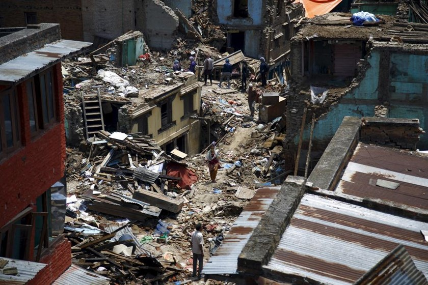 People walk along the debris of the collapsed houses after a fresh 7.3-magnitude earthquake struck Nepal, in Sankhu on May 12, 2015. Photo: Reuters/Navesh Chitrakar