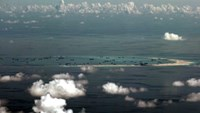 An aerial photo taken though a glass window of a Philippine military plane shows the alleged on-going land reclamation by China on mischief reef in the Spratly Islands in the South China Sea, west of Palawan, Philippines, May 11, 2015. Photo: Reuters/ Rit