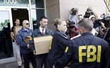 FBI agents bring out boxes after an operation inside the CONCACAF (Confederation of North, Central America and Caribbean Association Football) offices in Miami Beach, Florida May 27, 2015. Photo: Reuters/Javier Galeano