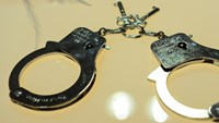 File photo of handcuffs. Photo: AFP/Emmanuel Dunand