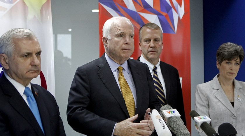 U.S. Senator John McCain (2nd L) (R-AZ), Chairman of the Senate Armed Services Committee, speaks with media at a news conference in Ho Chi Minh City, Vietnam May 29, 2015. Photo: Reuters/Do Khuong Duy