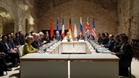 Negotiators of Iran and six world powers face each other at a table in the historic basement of Palais Coburg hotel in Vienna April 24, 2015. Photo: Reuters/Heinz-Peter Bader