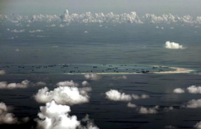 An aerial photo taken though a glass window of a Philippine military plane shows the alleged on-going land reclamation by China on mischief reef in the Spratly Islands in the South China Sea, west of Palawan, Philippines, May 11, 2015. Photo: Reuters/Ritc