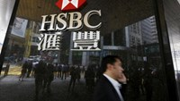 A man walks past a logo of HSBC outside a branch at the financial Central district in Hong Kong, China June 2, 2015. Photo: Reuters/Bobby Yip