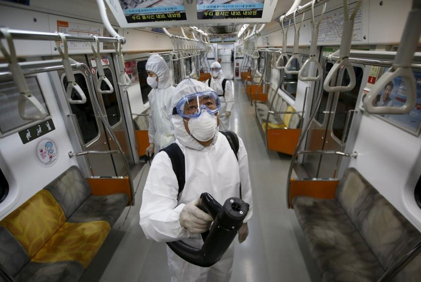 Workers in full protective gear disinfect the interior of a subway train at a Seoul Metro's railway vehicle base in Goyang, South Korea, June 9, 2015. Photo: Reuters /Kim Hong-Ji