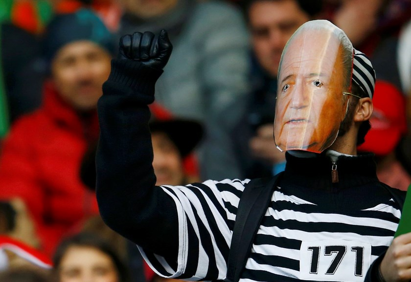 A Brazil fan wearing a mask of FIFA president Sepp Blatter awaits the start of his team's first round Copa America 2015 soccer match against Peru at Estadio Municipal Bicentenario German Becker in Temuco, Chile, June 14, 2015. Photo: Reuters/Ricardo Moraes
