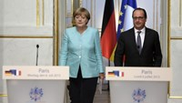 French President Francois Hollande and German Chancellor Angela Merkel arrive at a joint statement at the Elysee Palace in Paris, France, July 6, 2015 following the Greek people's resounding 'No' to a European cash-for-reform deal in a referendum in Greece. Photo: Reuters/Philippe Wojazer