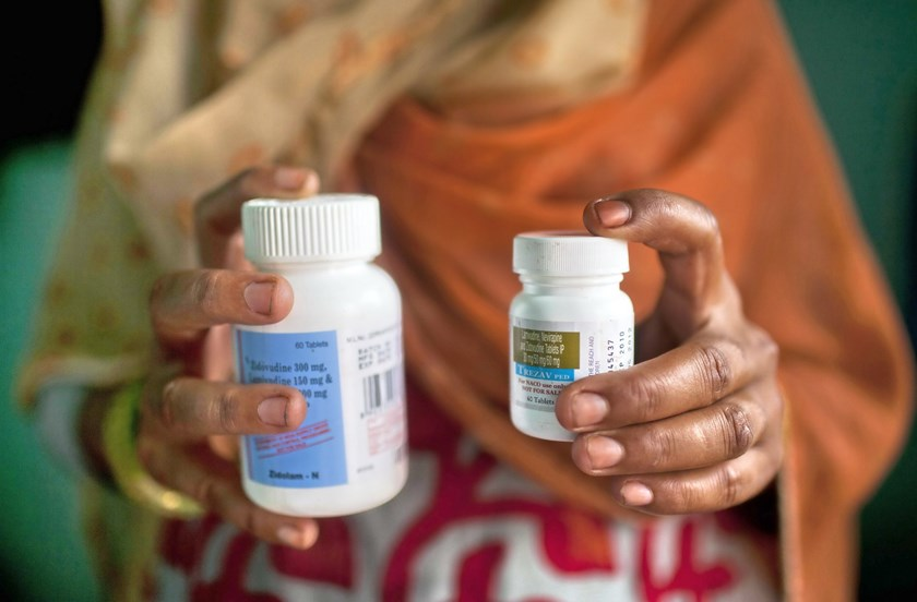 A file picture taken on July 23, 2012 shows Indian HIV-infected women posing with her antiretroviral drugs at her home in New Delhi. Photo: AFP/Andrew Caballero-Reynolds