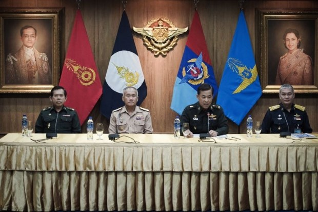 General Worapong Sanganetra (2nd R), chief of the Thai Defence Forces, speaks as Air Chief Marshal Jom Rungsawang (R), Army General Sujin Eimpee (L), and Navy Admiral Kraisorn Chansuwanit (2nd L) look on at the Thai Armed Forces headquarters in Bangkok on May 26, 2015. Photo: AFP