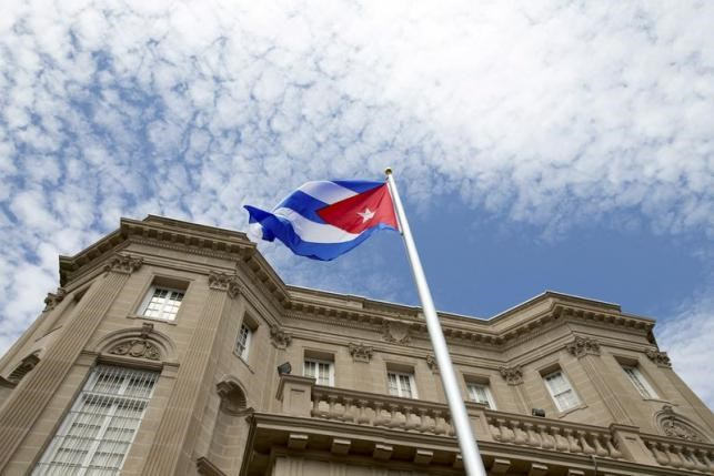 The Cuban national flag is seen raised over their new embassy in Washington, July 20, 2015. Photo: Reuters/Andrew Harnik
