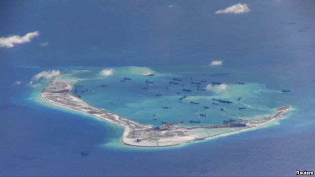 Chinese dredging vessels are purportedly seen in the waters around Mischief Reef in the disputed Spratly Islands in the South China Sea in this still image from video taken by a P-8A Poseidon surveillance aircraft provided by the United States Navy, May 2, 2015