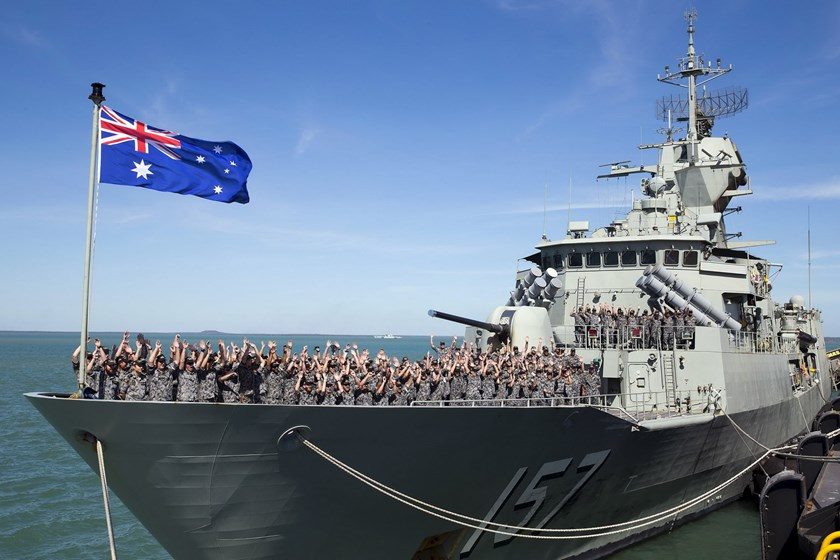 The crew of the Royal Australian Navy Anzac class frigate HMAS Perth cheer as they arrive at the Northern Australian city of Darwin in this picture taken on July 3, 2015. Photo: Reuters/Australian Defense Force/Handout via Reuters