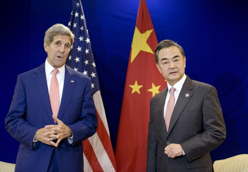 China's Foreign Minister Wang Yi (R) listens while US Secretary of State John Kerry talks before a bilateral meeting at the Putra World Trade Center August 5, 2015 in Kuala Lumpur, Malaysia. Photo: Reuters/Brendan Smialowski/Pool