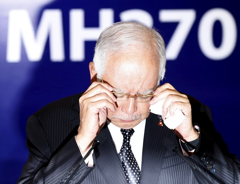 Malaysia's Prime Minister Najib Razak adjusts his glasses before confirming the debris found on Reunion Island is from missing Malaysia Airlines flight MH370 in Kuala Lumpur, Malaysia, August 6, 2015. Photo: Reuters/Olivia Harris