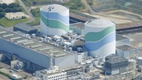 An aerial view shows the No.1 (L) and No.2 reactor buildings at Kyushu Electric Power's Sendai nuclear power station in Satsumasendai, Kagoshima prefecture, Japan, August 11, 2015, in this photo taken by Kyodo. Photo: Reuters/Kyodo