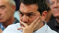Greek Prime Minister Alexis Tsipras attends a meeting at the Agriculture Ministry in central Athens, Greece, August 5, 2015. Photo: Reuters/Yiannis Kourtoglou