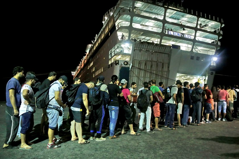 "Syrian refugees prepare to board the passenger ship ""Eleftherios Venizelos"" at the port on the Greek island of Kos, August 15, 2015. The vessel will house more than 2500 refugees and migrants who entered the country from theTurkish coast and will be used as a registration center for migrants. Photo: Reuters/Alkis Konstantinidis"