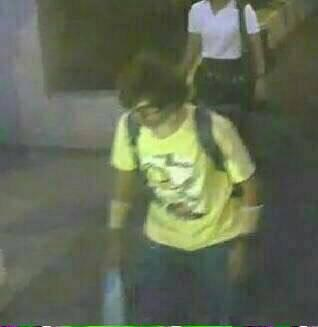 A man wearing a yellow T-shirt and carrying a backpack is seen walking near the Erawan shrine, where a bomb blast killed 22 people on Monday, in Bangkok, Thailand in this handout still image taken from closed-circuit television (CCTV) footage, released by the Thai Police on August 18, 2015. Reuters/Thai Police/Handout via Reuters