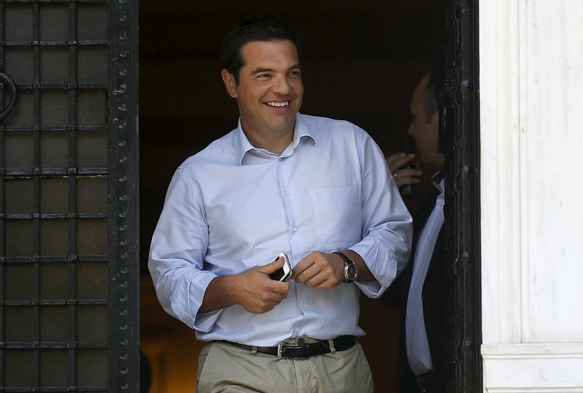 Greek Prime Minister Alexis Tsipras leaves his office at Maximos Mansion in Athens, Greece, August 20, 2015. Tsipras is due to meet senior advisers shortly to discuss whether to call early elections to quell a rebellion in his leftist Syriza party, a government official said on Thursday. Photo: Reuters/Stoyan Nenov