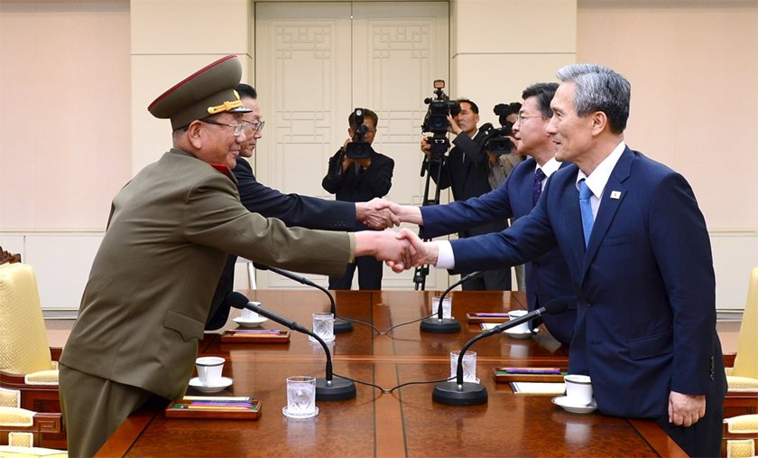 South Korean National Security Adviser Kim Kwan-jin (R), South Korean Unification Minister Hong Yong-pyo (2nd R), Secretary of the Central Committee of the Workers' Party of Korea Kim Yang Gon (2nd L), and the top military aide to the North's leader Kim Jong Un Hwang Pyong-so (L), shake hands during the inter-Korean high-level talks at the truce village of Panmunjom inside the Demilitarized Zone separating the two Koreas, South Korea, in this picture provided by the Unification Ministry and rele