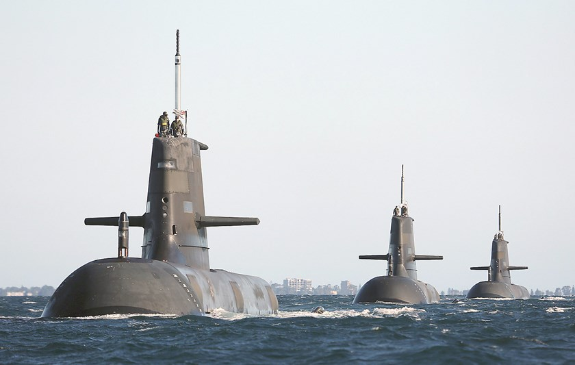 In this handout photo taken in March 2013, Royal Australian Navy submarines (from left) HMAS Dechaineux, HMAS Waller and HMAS Sheean leave in formation from the Royal Australian Navy's HMAS Stirling base near the west coast city of Perth. Photo: Australia Defense Force/Reuters