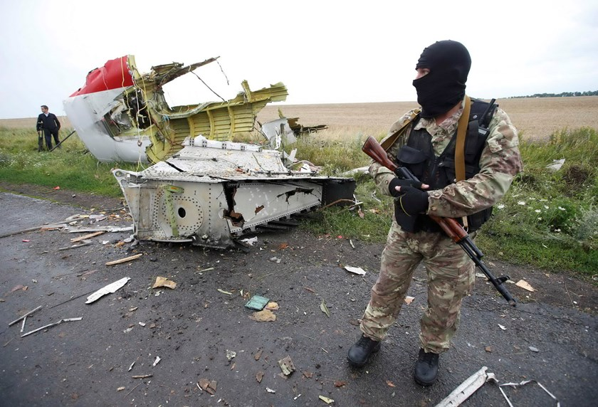 A pro-Russian separatist standing at the crash site of Malaysia Airlines flight MH17, near the settlement of Grabovo in the Donetsk region, is seen in this July 18, 2014 file photo. Photo: Reuters/Maxim Zmeyev