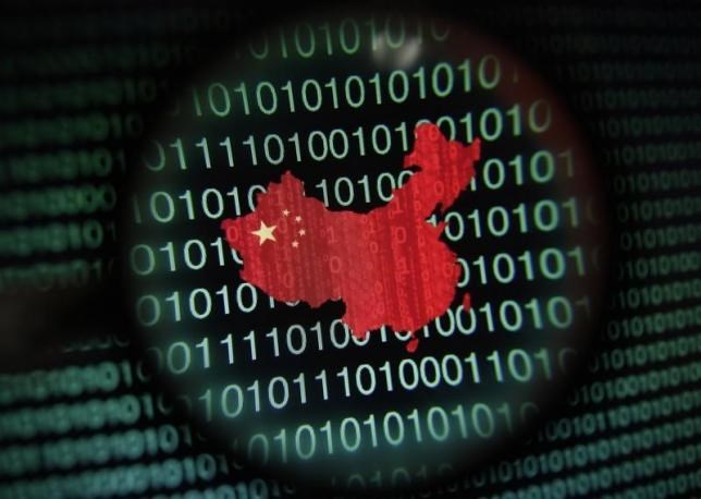 A map of China is seen through a magnifying glass on a computer screen showing binary digits in Singapore in this January 2, 2014 photo illustration. Photo: Reuters/Edgar Su