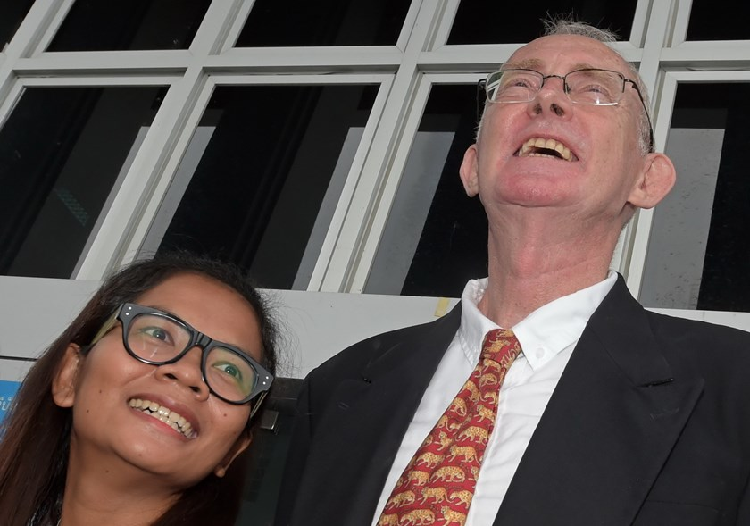 Australian journalist Alan Morison (R) and Thai colleague Chutima Sidasathian (L) smile while answering questions from the media after they were found not guilty of criminal defamation at the provincial court in Phuket island on September 1, 2015. Two journalists, including an Australian editor, were found not guilty of criminal defamation by a Thai court, their lawyer said, over a report implicating the kingdom's navy in human trafficking. Photo: AFP/Pornchai Kittiwongsakul