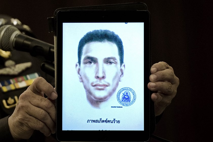 Thailand's national police spokesman Prawut Thavornsiri holds a tablet displaying a picture of an unnamed foreign man wanted by the police at the police headquarters in central Bangkok on September 1, 2015. Photo: AFP/Nicolas Asfouri