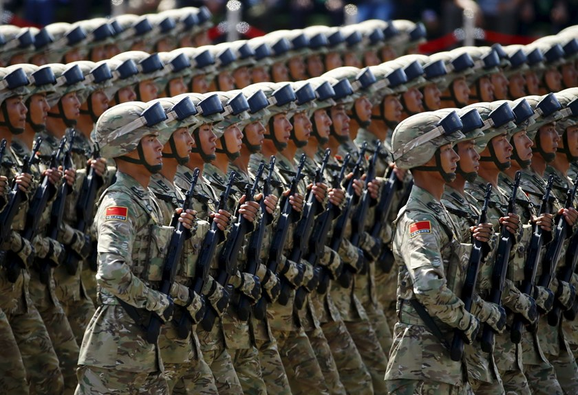 Soldiers of China's People's Liberation Army (PLA) march during the military parade marking the 70th anniversary of the end of World War Two, in Beijing, China, September 3, 2015. Photo: Reuters/Damir Sagolj