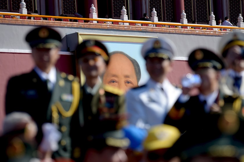 A portrait of Mao Zedong is seen as a group of Chinese military officers stand in a reviewing stand at Tiananmen Square before the military parade marking the 70th anniversary of the end of World War Two, in Beijing, China, September 3, 2015. Photo: Reuters/Wang Zhao