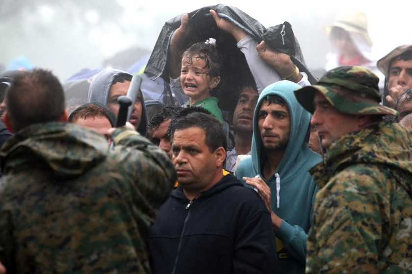 A child cries as migrants and refugees wait to cross the Greek-Macedonian border near the village of Idomeni, in northern Greece on September 10, 2015. Photo: AFP/Sakis Mitrolidis