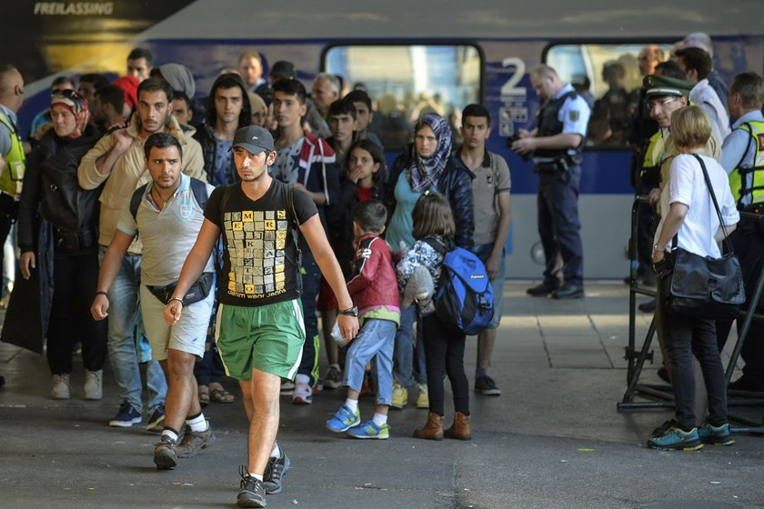 Migrants arrive at the railway station in Munich, southern Germany on September 12, 2015. Photo: AFP/Philipp Guelland