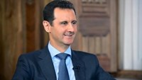 Syria's President Bashar al-Assad answers questions during an interview with al-Manar's journalist Amro Nassef, in Damascus, Syria, in this handout photograph released by Syria's national news agency SANA on August 25, 2015. Photo: Reuters/SANA